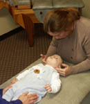 Dr. Laura Gross adjusts infants, toddlers, kids and adults of all ages